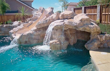 Water Slide Over Partially Submerged Cave For The Kids To Play In