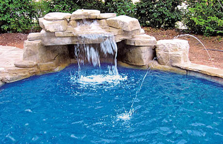 hidden loveseat behind a modest waterfall - Swimming Pools With Grottos